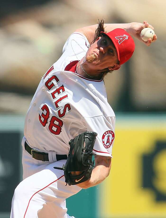 ANAHEIM, CA - SEPTEMBER 13: Jered Weaver #36 of the Los Angeles Angels of Anaheim pitches against the Oakland Athletics in the first inning during the MLB game at Angel Stadium of Anaheim on September 13, 2012 in Anaheim, California. (Photo by Victor Decolongon/Getty Images) Photo: Victor Decolongon, Getty Images