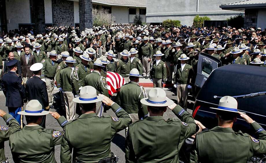 Law enforcement officers salute the casket of Kenyon Youngstrom, the CHP patrolman shot during a traffic stop Sept. 4. Photo: Michael Macor, The Chronicle