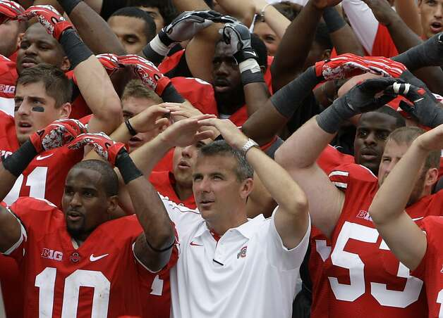 "Urban Meyer (center) and the Buckeyes sing the 110-year-old ditty, ""Carmen Ohio,"" after Ohio State's season-opening rout. Photo: Jay LaPrete, Associated Press"