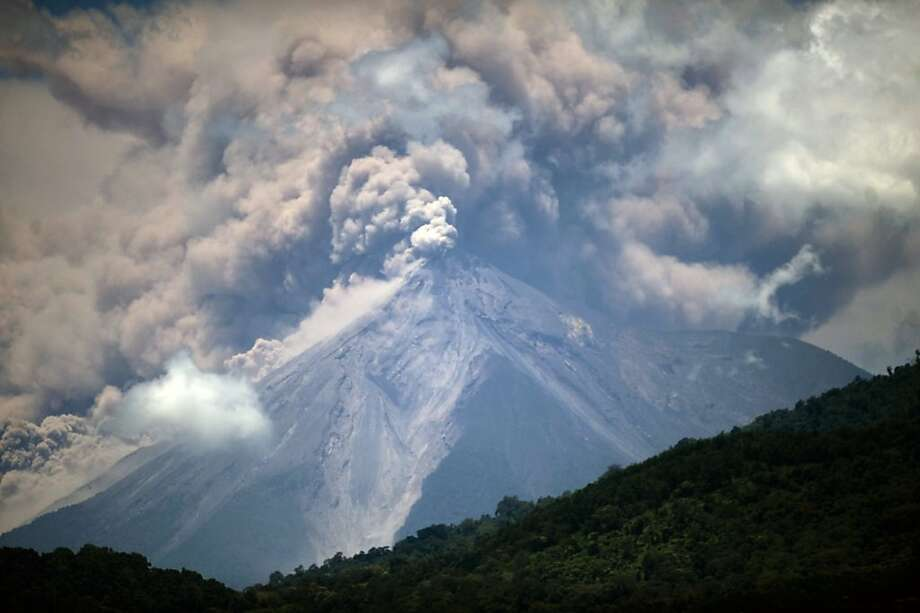 Powerful eruptions from the Volcan del Fuego send clouds of ash billowing into the sky and threaten 17 villages near the colonial city of Antigua. Photo: Johan Ordonez, AFP/Getty Images