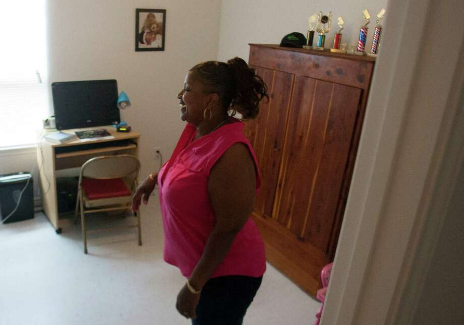 Karen Ladet takes a look inside her new office after the dedication ceremony of her new Habitat for Humanity home. Photo: J. Patric Schneider, For The Chronicle / © 2012 Houston Chronicle