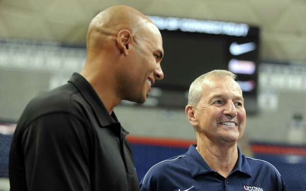 Former University of Connecticut player Donny Marshall stands beside former UConn Coach Jim Calhoun during a media conference at Harry A.Gampel Pavilion in Storrs, Conn. on Thursday, Sept. 13, 2012. Photo: Autumn Driscoll / Connecticut Post