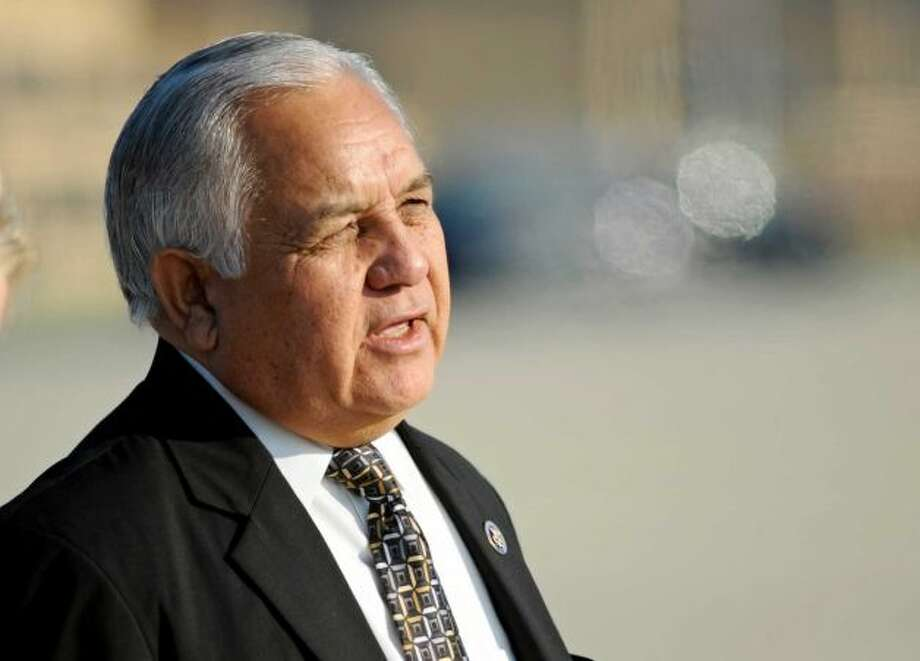 Rep. Silvestre Reyes awaits President Obama outside Air Force One during a presidential trip to El Paso.