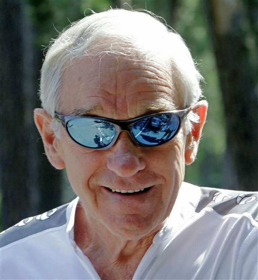 Republican presidential candidate, Rep. Ron Paul, Texas takes a break from the campaign as he gets ready to go for a bike ride, Friday, Sept. 2, 2011, in Manchester, N.H. Photo: Jim Cole, AP / AP