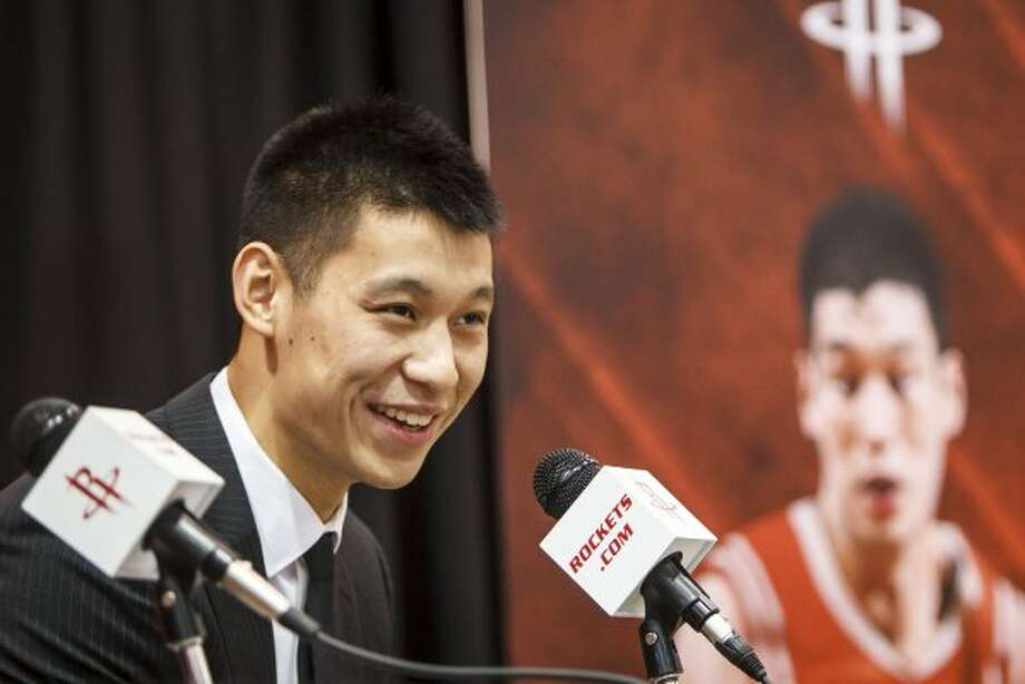 July 19:Former New York Knicks point guard Jeremy Lin is introduced by the Rockets two days after the Knicks declined to match Houston's three-year offer sheet. Lin signed a three-year, $25.1 million contract with the Rockets. (Michael Paulsen / Houston Chronicle)
