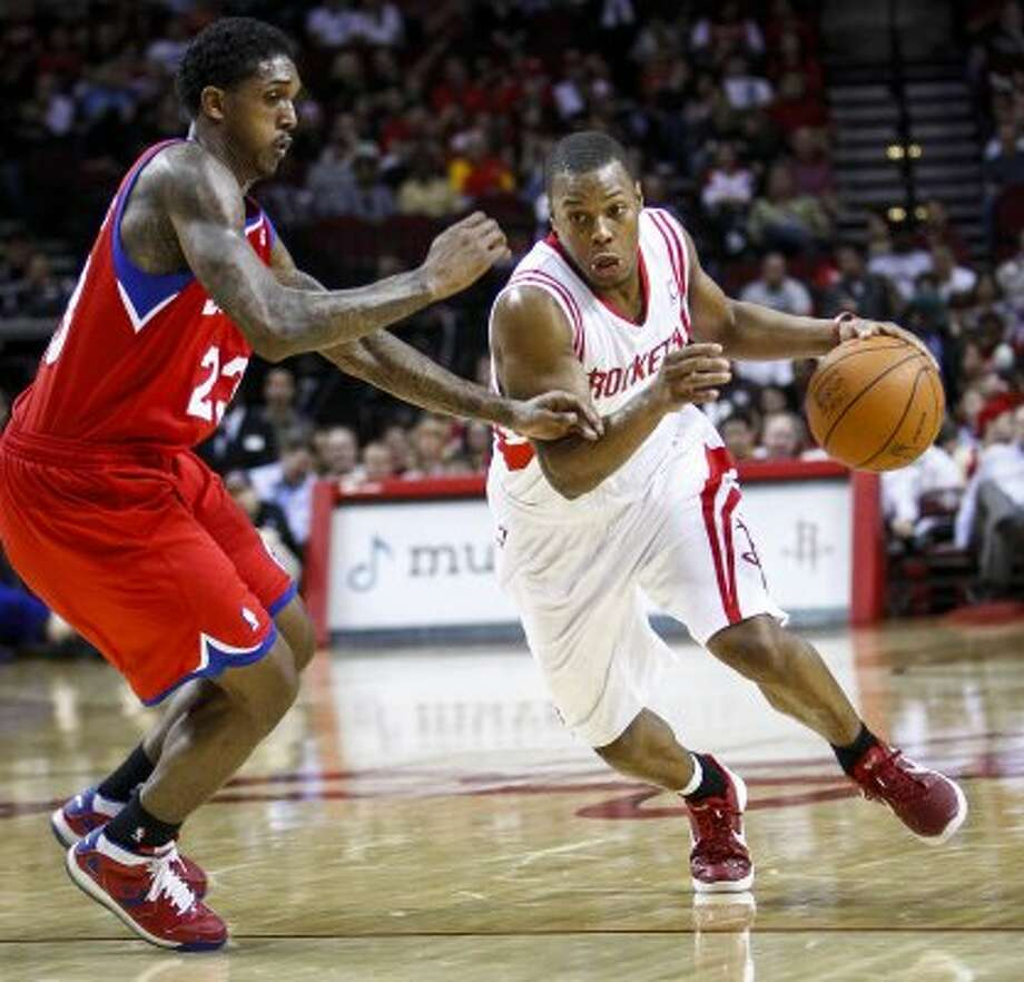 July 11:Point guard Kyle Lowry is traded to the Toronto Raptors for a future first-round lottery pick and forward Gary Forbes. (Michael Paulsen / Houston Chronicle)