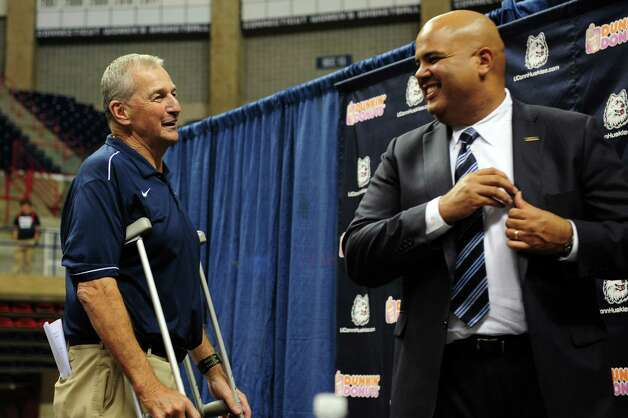 Former University of Connecticut Coach Jim Calhoun talks with UConn athletic director Warde Manuel  after announcing his retirement after 26 years during a media conference at Harry A.Gampel Pavilion in Storrs, Conn. on Thursday, Sept. 13, 2012. Photo: Autumn Driscoll / Connecticut Post