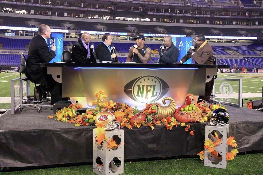 The NFL Network studio desk can get a little overcrowded at times. (Ben Liebenberg/NFL) Photo: Ben Liebenberg / 2011 National Football League
