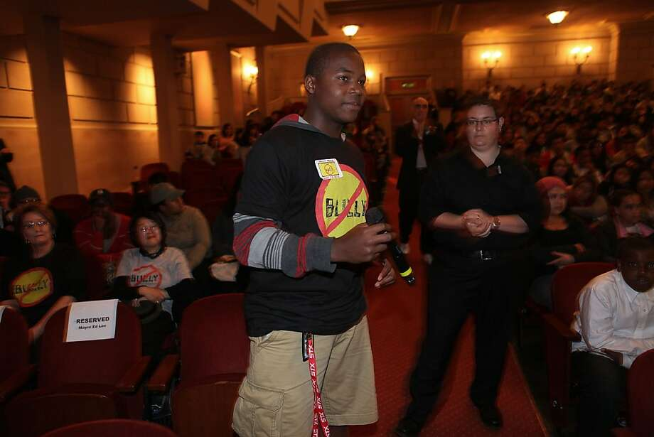 "George Washington High School student Delvon Carter, 14, asks a question about the movie ""Bully"" at Herbst Theatre. About 2,800 San Francisco students were bused to see the film at four theaters. Photo: Liz Hafalia, The Chronicle"