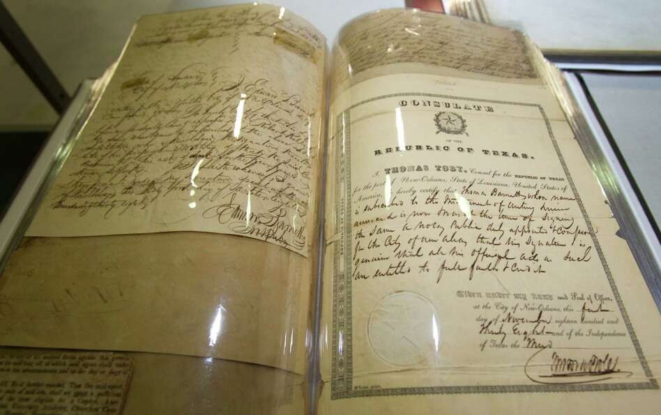 Documents from the 1830s are displayed during an open house and tour of the new Harris County Electi