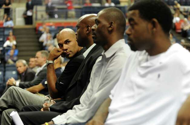 Former University of Connecticut player Donny Marshall and other players listen as UConn Coach Jim Calhoun announces his retirement after 26 years during a media conference at Harry A.Gampel Pavilion in Storrs, Conn. on Thursday, Sept. 13, 2012. Photo: Autumn Driscoll / Connecticut Post