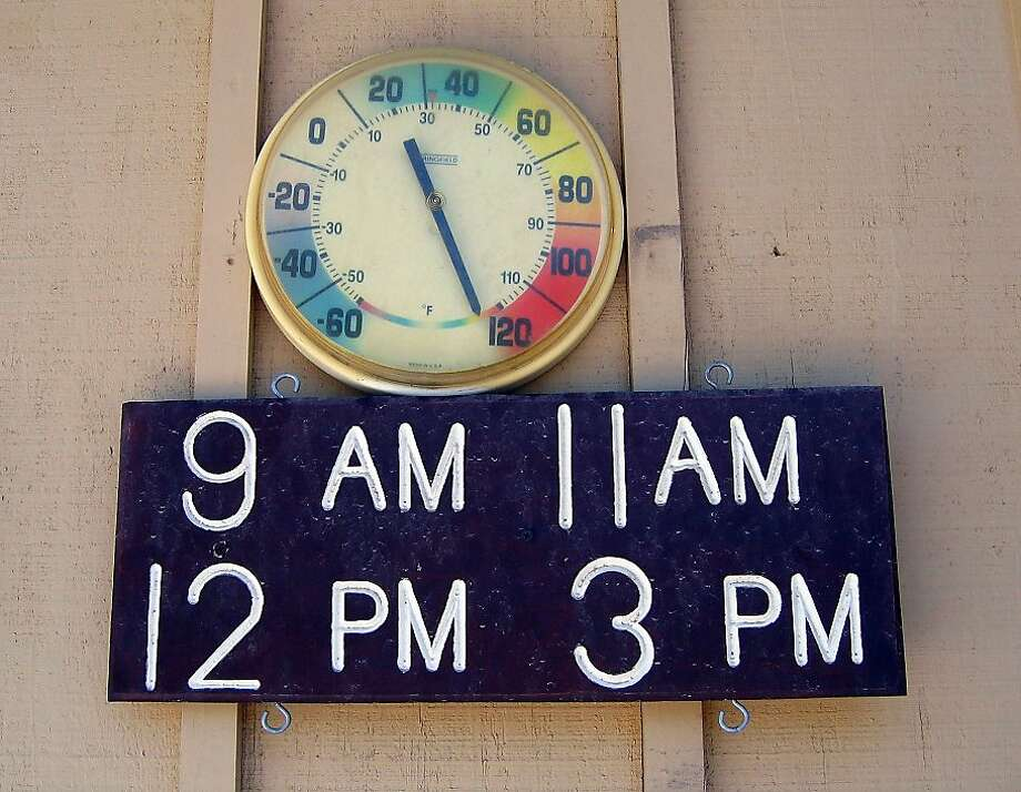 At Furnace Creek Ranch in Death Valley a thermometer tops out at 128 degrees Fahrenheit on July 17, 2005. The 134-degree record was set in 1913. Photo: Deiner