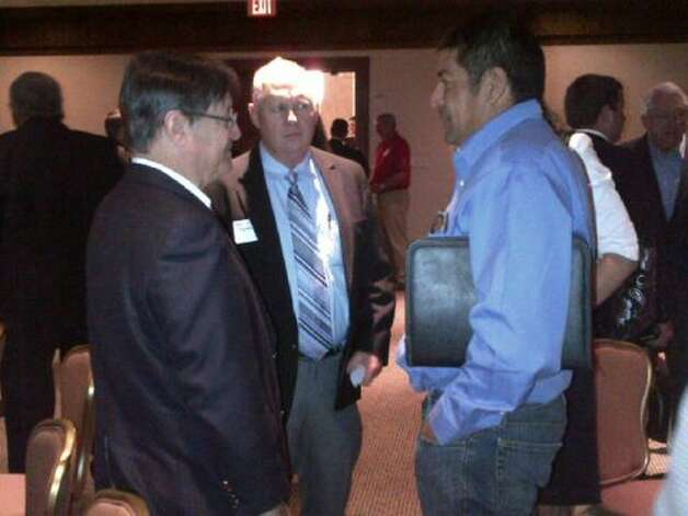 "Rep. Francisco ""Quico"" Canseco talks with energy roundtable participants. (Rep. Canseco Twitter feed)"