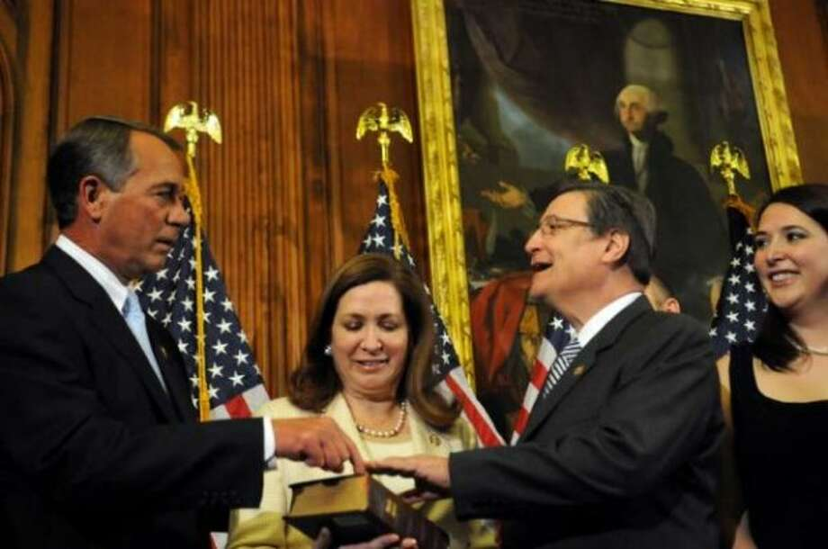 Quico Canseco's ceremonial swearing-in with House Speaker John Boehner, January 2011. (AP)