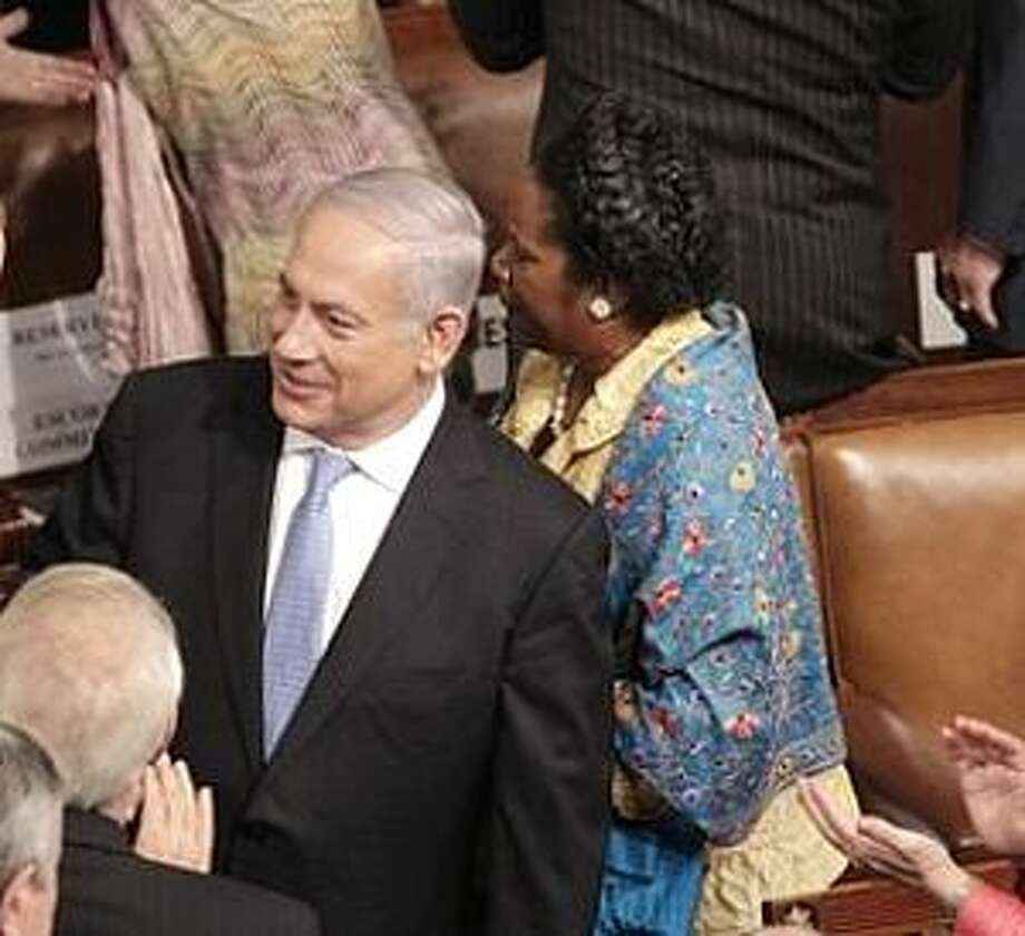 Israel's Prime Minister Benjamin Netanyahu arrives on Capitol Hill in Washington, Tuesday, May 24, 2011, to address a joint meeting of Congress. House Majority Leader Eric Cantor of Va. is at left, Rep. Sheila Jackson Lee, D-Texas is right.  (AP Photo/J. Scott Applewhite) Photo: AP