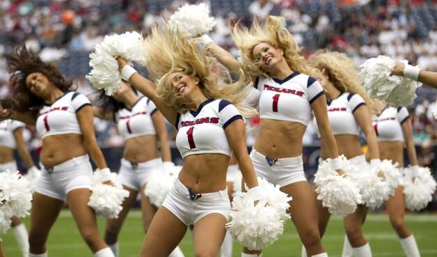Houston Texans cheerleaders perform a routine before the Texans season opener against the Miami Dolphins. (Brett Coomer / Houston Chronicle)