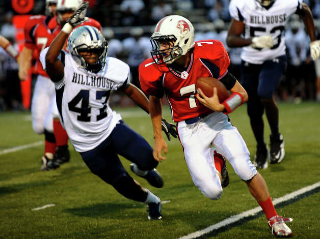 Foran QB #7 Jake Kasuba looks to evade Hillhouse's #47 Facinete Haderia as he carries the ball, during boys football action in Milford, Conn. on Thursday September 13, 2012. Photo: Christian Abraham / Connecticut Post