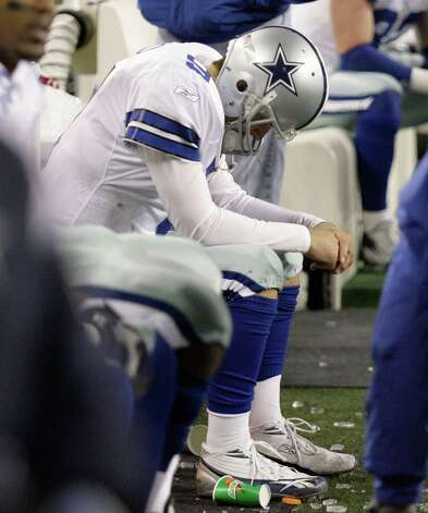 Cowboys' quarterback Tony Romo lowers his head while sitting on the bench following his fumble to the Seattle Seahawks' during the final minutes of their NFC wild card playoff football game Saturday, Jan. 6, 2007, in Seattle.The Seahawks defeated the Cowboys, 21-20.(AP Photo/Rick Bowmer) Photo: Rick Bowmer, Express-News / AP