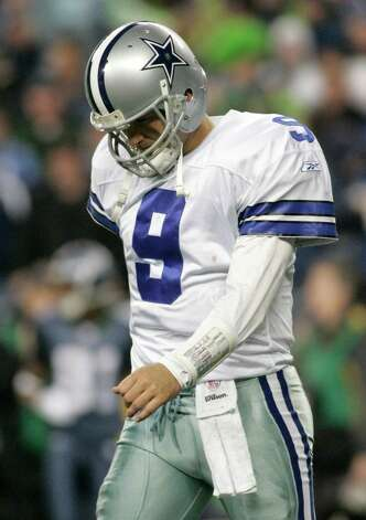 Cowboys' quarterback Tony Romo walks off the field after fumbling a snap on a field goal in the fourth quarter of their NFC Wild Card NFL playoff football game against the Seattle Seahawks in Seattle, January 6, 2007. REUTERS/Steve Dipaola Photo: ROBERT SORBO, Express-News / X01045