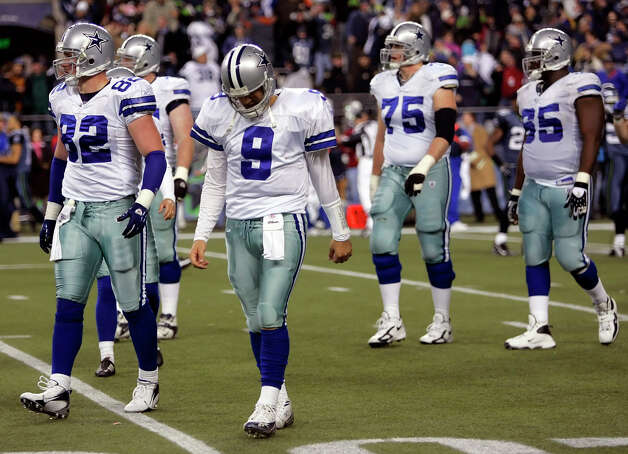 Cowboys quarterback Tony Romo walks off the field Saturday January 6, 2007 in Seattle after bobbling the hold on a last second field goal to lose to the Seahawks' in the NFC Wildcard game. Photo: WILLIAM LUTHER, Express-News / San Antonio Express-News