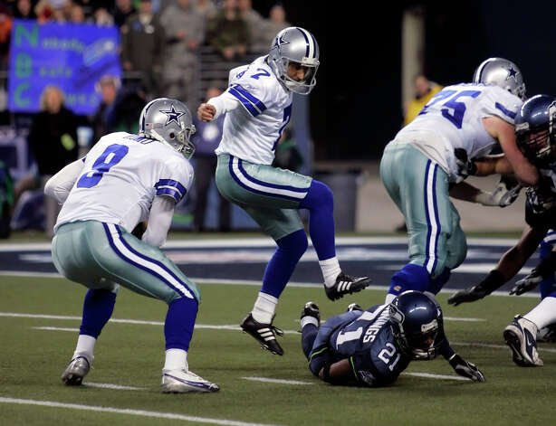 Cowboys quarterback Tony Romo, left, picks up the ball Saturday January 6, 2007 in Seattle after bobbling the snap to break-up a last second field goal attempt that would have given the Cowboys the win in the NFC wild card game. The Seahawks won 21-20. Photo: WILLIAM LUTHER, Express-News / San Antonio Express-News
