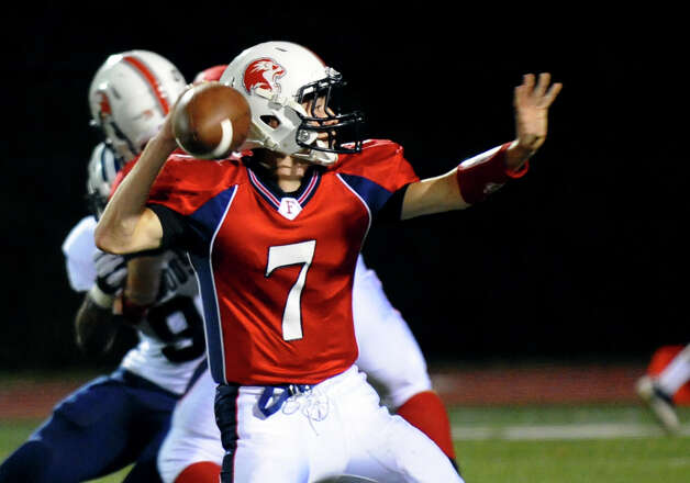 Foran QB #7 Jake Kasuba prepares to pass the ball, during boys football action against Hillhouse in Milford, Conn. on Thursday September 13, 2012. Photo: Christian Abraham / Connecticut Post