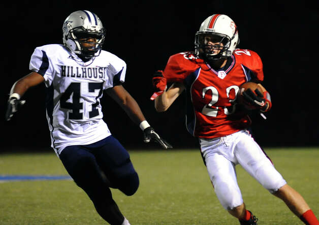 Foran's #23 Connor Cadrin carries the ball as Hillhouse's #47 Facinete Haderia looks to tackle, during boys football action in Milford, Conn. on Thursday September 13, 2012. Photo: Christian Abraham / Connecticut Post