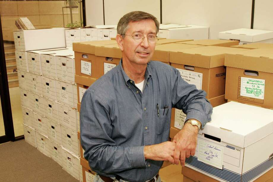 Ronnie Veselka, who is coordinating the central office move for the Houston Independent School District, is seen with boxed-up files ready to be moved from the currrent administration office at 3830 Richmond. Photo: Bruce Bennett / Freelance