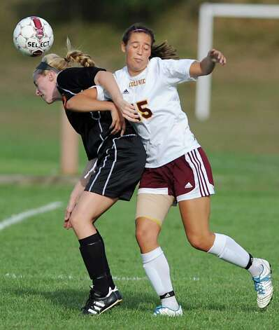 From left, Bethlehem's Samantha Taillon and Colonie's Emily Green battle for the ball during a soccer game Tuesday, Sept. 11, 2012 in Colonie, N.Y. (Lori Van Buren / Times Union) Photo: Lori Van Buren