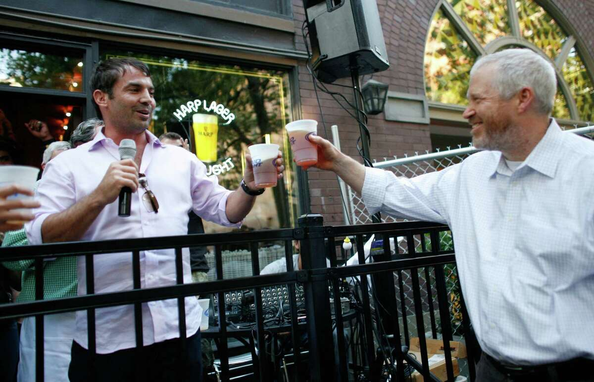 Seattle Mayor Mike McGinn toasts Chris Hansen during a gathering at FX McRory's.