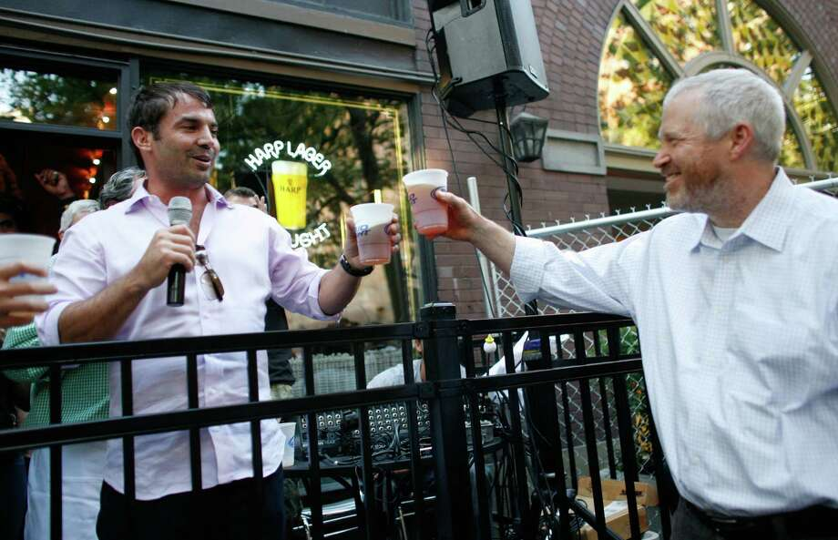 Seattle Mayor Mike McGinn toasts Chris Hansen during a gathering at FX McRory's. Photo: JOSHUA TRUJILLO / SEATTLEPI.COM