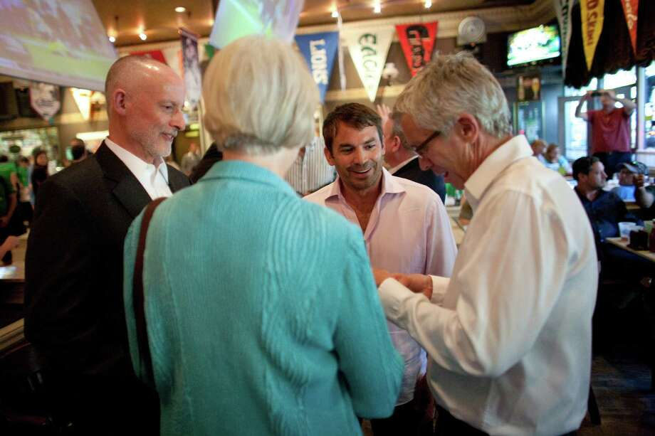 From left, Seattle City Council members Tim Burgess and Sally Bagshaw speak to arena investor Chris Hansen at FX McRory's. Photo: JOSHUA TRUJILLO / SEATTLEPI.COM