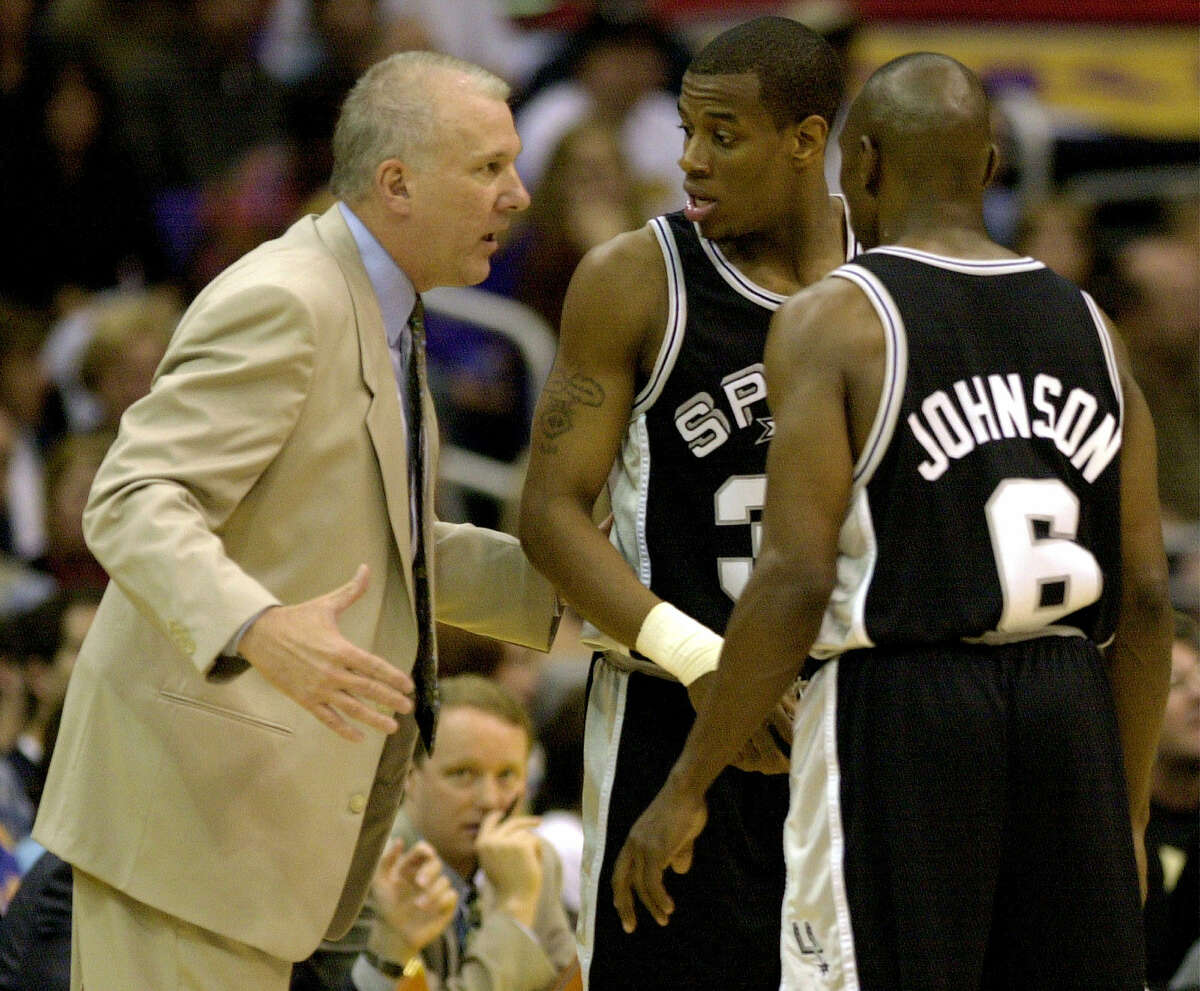 In a Q&A, former Spurs player Antonio Daniels, center, reflects on when Popovich gave Daniels' starting spot to Tony Parker, then 19. Pictured, Spurs coach Gregg Popovich talks to Daniels and Avery Johnson during first period at the Staples Center in Los Angeles, May 27, 2001.