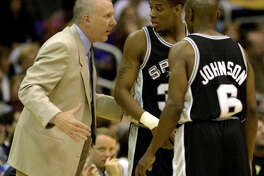 Spurs coach Gregg Popovich talks to Antonio Daniels and Avery Johnson during first period at the Staples Center in Los Angeles, May 27, 2001.