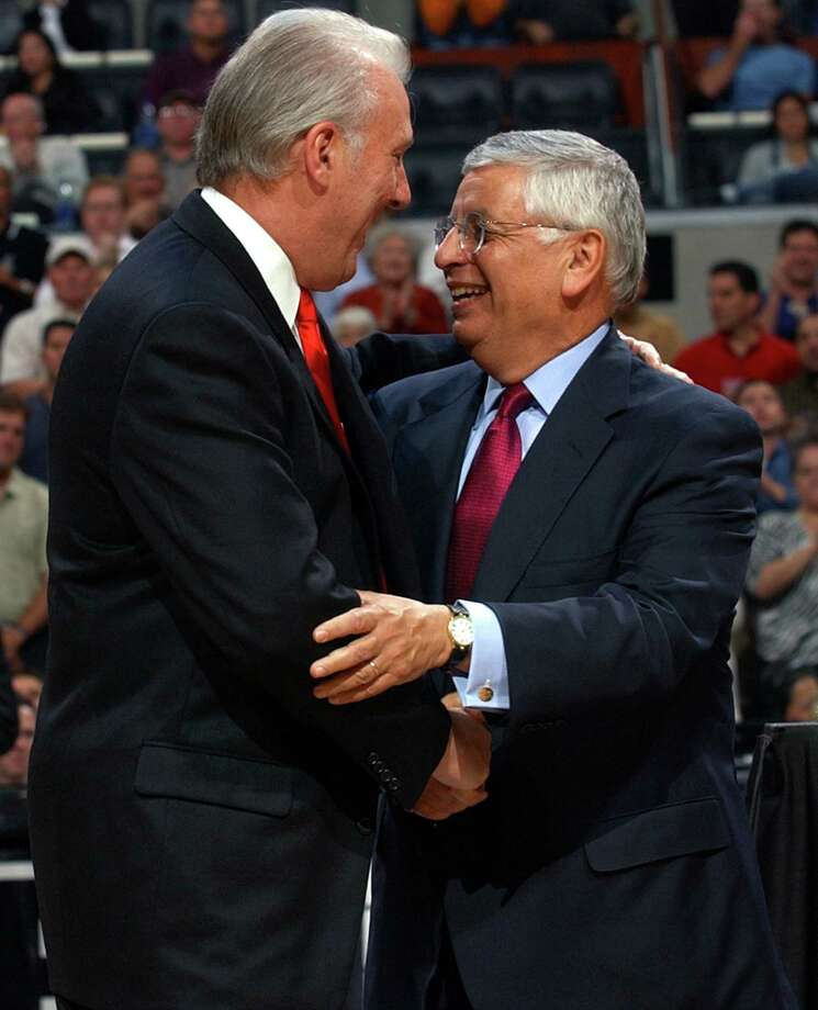 NBA Commissioner David Stern (right) greets Spurs coach Gregg Popovich during the Spurs' championship ring ceremony Oct. 28, 2003 at the SBC Center before the start of their game against the Phoenix Suns. Photo: WILLIAM LUTHER, SAN ANTONIO EXPRESS-NEWS / SAN ANTONIO EXPRESS-NEWS