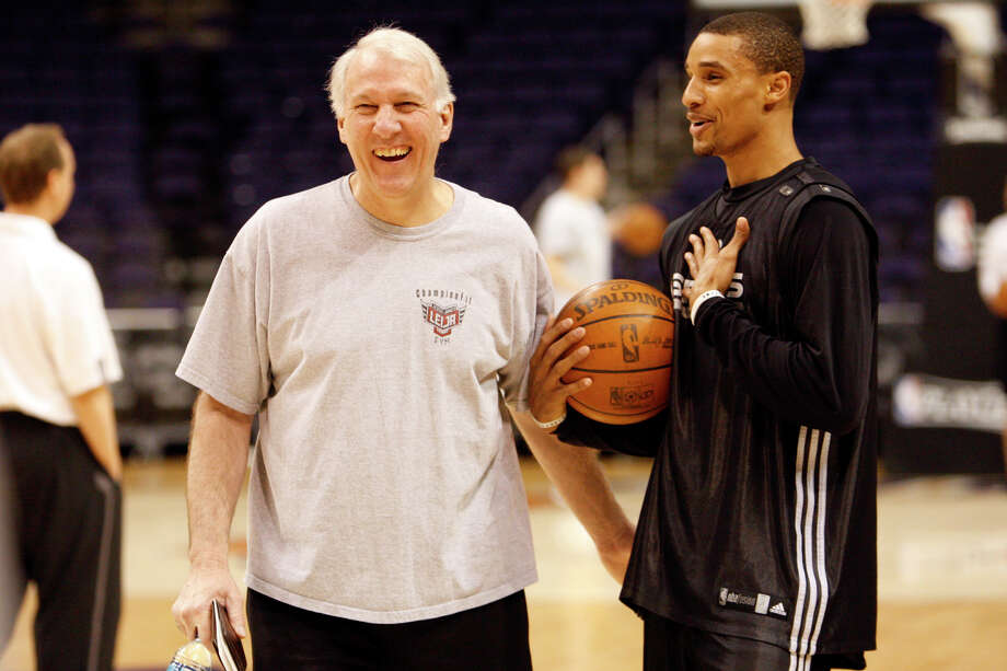 Spurs coach Gregg Popovich laughs with guard George Hill during practice at the U.S. Airways Center in Phoenix, Tuesday, May 4, 2010. The Spurs lost the first game of a seven series in the Western Conference semi-finals against the Phoenix Suns. Photo: Kin Man Hui, San Antonio Express-News / kmhui@express-news.net