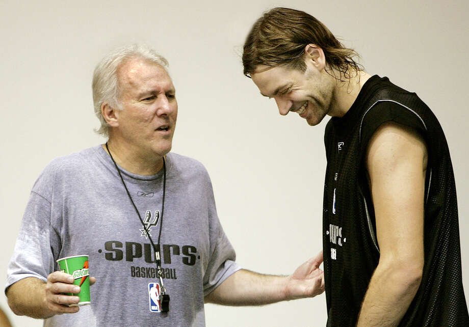 Spurs coach Gregg Popovich (left) jokes with player Fabricio Oberto at the end of the second practice of their training camp at the University of the Virgin Islands in Charlotte Amalie, St. Thomas, Oct. 5, 2005. Photo: ANDRES LEIGHTON, AP / AP