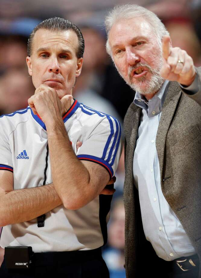 Spurs coach Gregg Popovich (right) argues a call with referee Ken Mauer in the fourth quarter of the Denver Nuggets' 104-96 victory over the Spurs in an NBA basketball game in Denver on Tuesday, Feb. 3, 2009. Photo: David Zalubowski, AP / AP