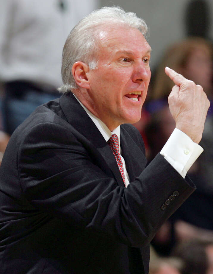 Coach Greg Popovich gestures at the refs in the first half Friday, April 7, 2006 at the AT&T Center. Popovich was later hit with a technical foul. Photo: BAHRAM MARK SOBHANI, SAN ANTONIO EXPRESS-NEWS / SAN ANTONIO EXPRESS-NEWS