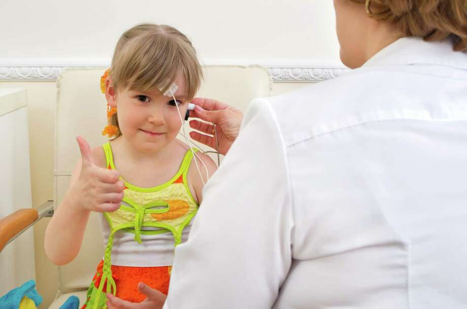 testing girl's ears Photo: Tatyana Sokolova / iStockphoto