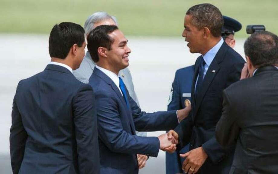 Julian Castro (in the blue tie) shakes hands with President Obama on July 17. The San Antonio mayor is flanked by his twin brother Joaquin.
