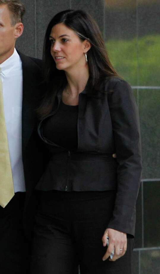 Laura Pendergest Holt, right, former chief investment officer for Stanford Financial Group Co., arrives at the Bob Casey Federal Courthouse for sentencing in Houston, Texas, U.S., on Thursday, Sept. 13, 2012. She was the third-highest-ranking executive in the financial services firm that Texas financier R. Allen Stanford built on what the U.S. said was a Ponzi scheme based on bogus offshore bank certificates. Photographer: Aaron M. Sprecher/Bloomberg ***Local Caption***Laura Pendergest Holt Photo: Aaron M. Sprecher / © 2012 Bloomberg Finance LP