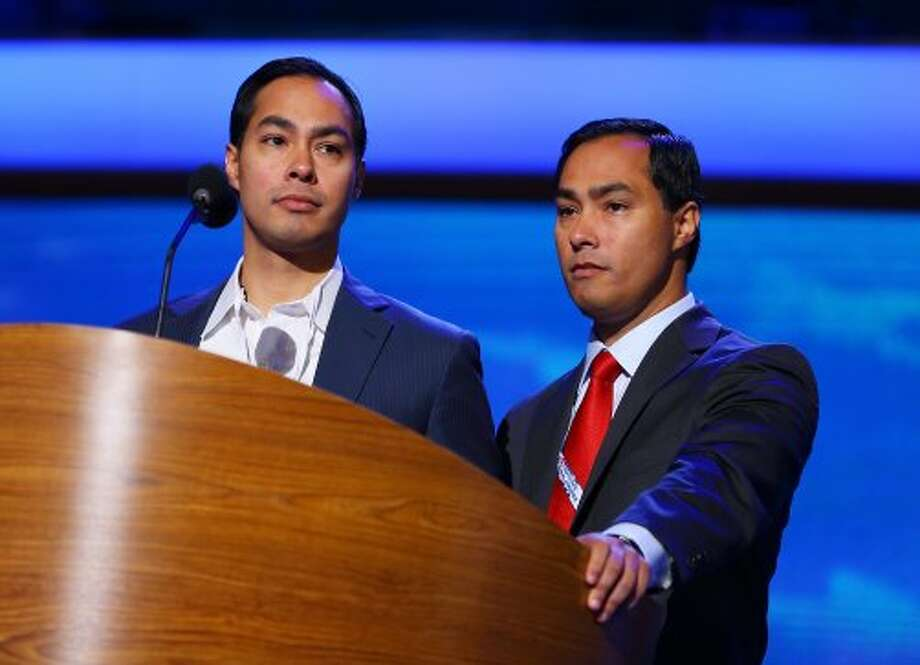 San Antonio Mayor Julian Castro, left, and brother Joaquin Castro stand at the podium during preparations for the Democratic National Convention at Time Warner Cable Arena on September 2, 2012 in Charlotte, North Carolina. The DNC that will start on September 4 and run through September 7, will nominate U.S. President Barack Obama as the Democratic presidential candidate.   (Joe Raedle / Getty Images)