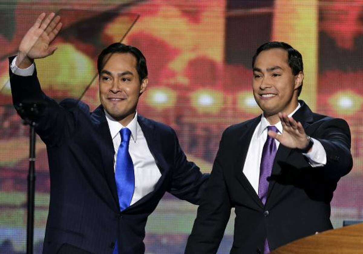 San Antonio Mayor Julian Castro and his brother Joaquin Castro, right, wave to the Democratic National Convention in Charlotte, N.C., on Tuesday, Sept. 4, 2012. (AP Photo/J. Scott Applewhite) (J. Scott Applewhite / Associated Press)