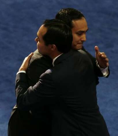 San Antonio Mayor Julian Castro, left, hugs his brother Joaquin Castro, at the Democratic National Convention in Charlotte, N.C., on Tuesday, Sept. 4, 2012. (AP Photo/Charlie Neibergall) (Charlie Neibergall / Associated Press)