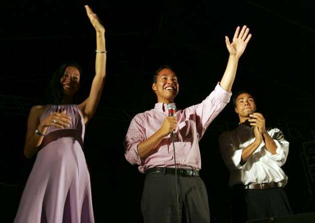 Councilman Julian Castro, center, candidate for San Antonio mayor, addresses the crowd Tuesday, June 7, 2005, in San Antonio at Castro's campaign headquarters. At left is his girlfriend, Erica Lira, and at right is his twin brother, Joaquin. Retired state judge Phil Hardberger held a narrow lead over Castro late Tuesday in the mayoral runoff.  (BAHRAM MARK SOBHANI / AP)