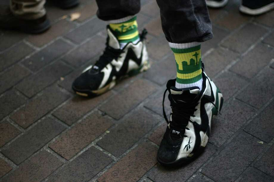 A SuperSonics supporter wears Sonics socks. Photo: JOSHUA TRUJILLO / SEATTLEPI.COM