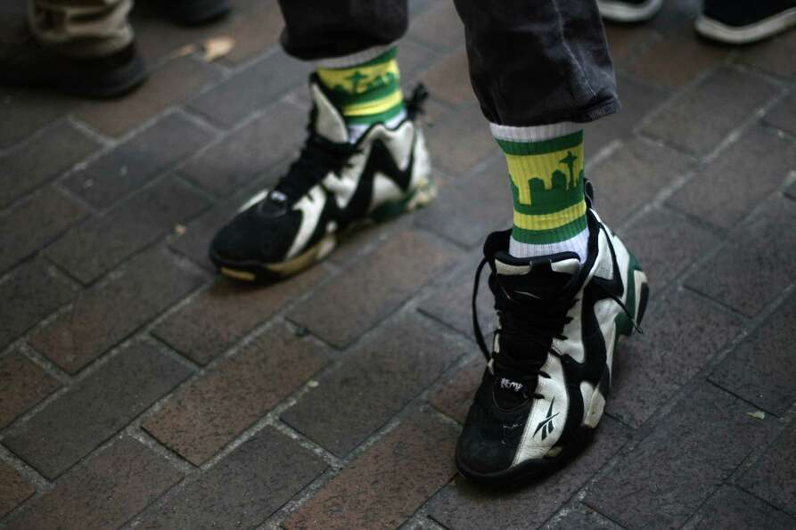 A SuperSonics supporter wears Sonics socks.