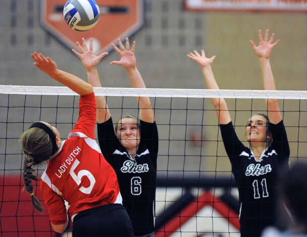 Guilderland's Allison VanDoren, left, hits the ball over the net as Shenendehowa's Hayley Maken and Michelle Paulsen, right, try to return it during a volleyball match Thursday, Sept. 13, 2012 in Guilderland, N.Y. (Lori Van Buren / Times Union) Photo: Lori Van Buren
