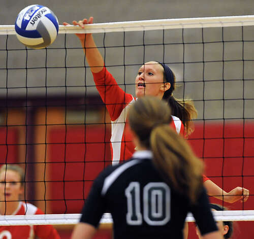Guilderland's Rebecca Straubel tips one over the net to score during a volleyball match against Shenendehowa Thursday, Sept. 13, 2012 in Guilderland, N.Y. (Lori Van Buren / Times Union) Photo: Lori Van Buren